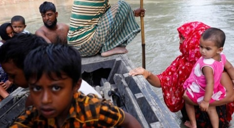 Pandemic job losses and flooding spark fears of hard times in Bangladesh