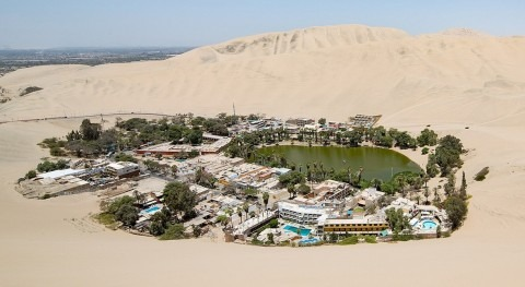 The Huacachina lake, Peruvian oasis in the middle of the desert
