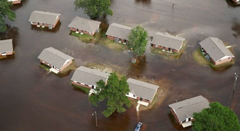 As climate risks rise, U.S. urged to update flood maps and building rules