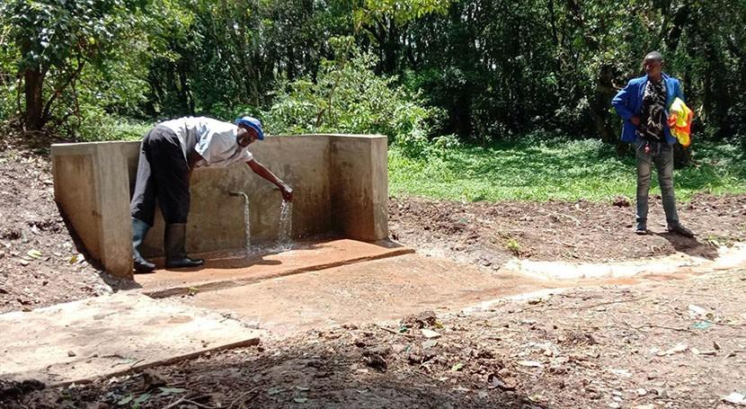 Kenyan villagers nurture local springs as founts of clean water