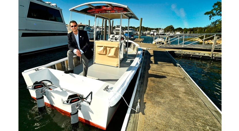Clean water and clean energy: the world's first solar-electric sewage pump-out boat